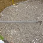 mein selbstgebauter Abzuszeiger, die Achse hatte ich voher ca 70 cm in den Lehmboden geschlagen